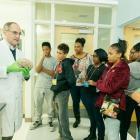 Dr. Givens holds a brain specimen