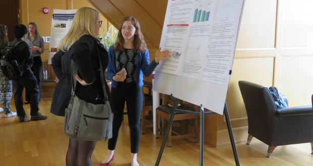 Megan Dailey presents her research poster at CogFest