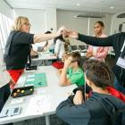 Dr. Beers assists students assemble model brains