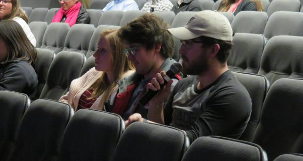 Audience member addresses his question to the panel of experts. Photo credit: Molly McKinney